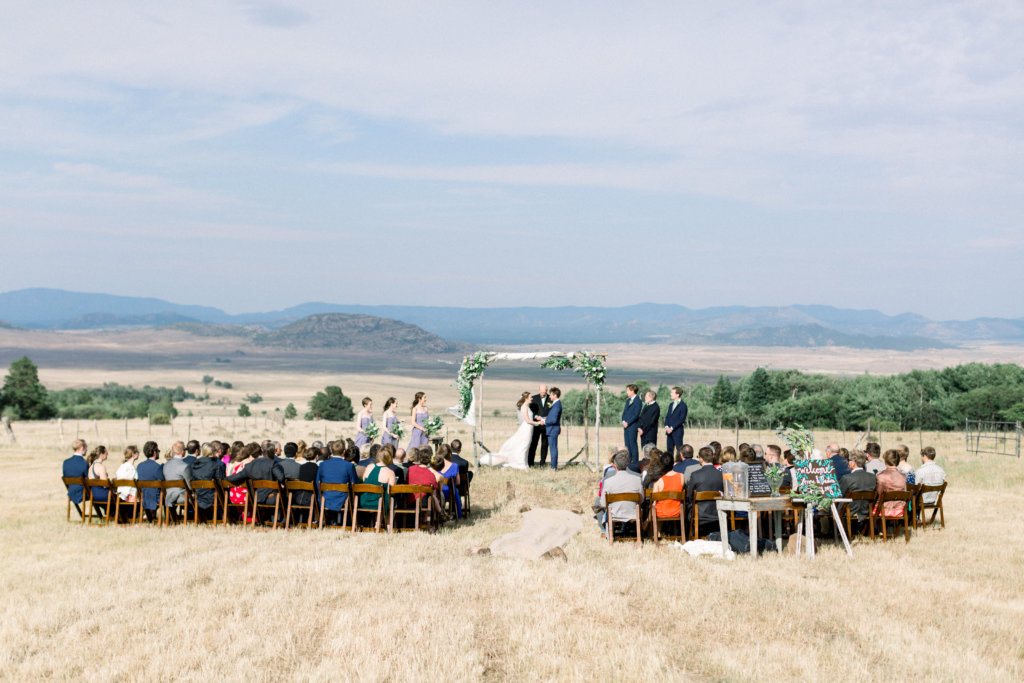 Fruitwood padded chairs and a Colorado overlook